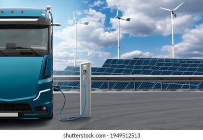 Elektrischer Lastwagen mit Ladestation auf dem Hintergrund von Solarpaneelen und Windturbinen. Konzept
