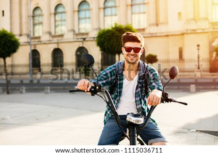 ff64587485da Electric urban transportation. happy young man sitting o his electric  transportation and smiling to camera