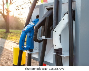 Electric Vehicle charger on highway parking lot future of personal transportation and refueling