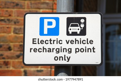 An electric vehicle charging point sign in a car park at Tenterden in Kent, England.