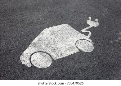 Electric vehicle charging sign applied on asphalt in parking lot in Trondheim, Norway.