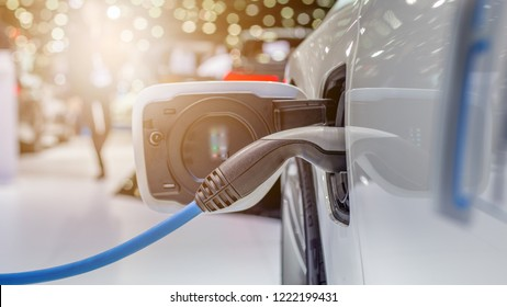 Electric vehicle charging station for home with EV car background