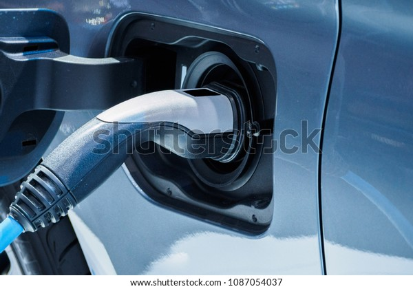 Electric vehicle charging station for home with EV car.