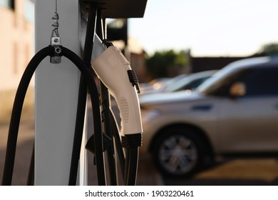 Electric vehicle charging station outdoors, closeup. Space for text