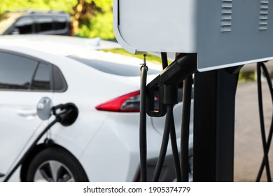 Electric vehicle charging station outdoors. Modern technology