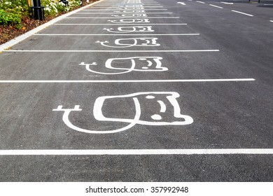 Electric vehicle charging station sign in a parking bay