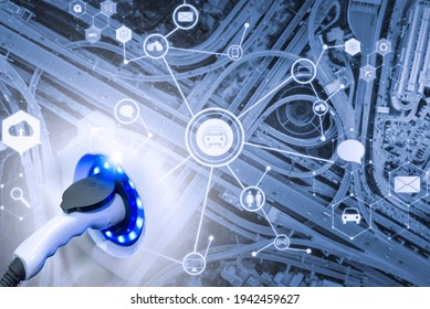 Electric vehicle , Smart car , Air pollution and reduce greenhouse gas emissions concept. Double exposure of charging Electric car with power cable supply plugged in and city. - Shutterstock ID 1942459627