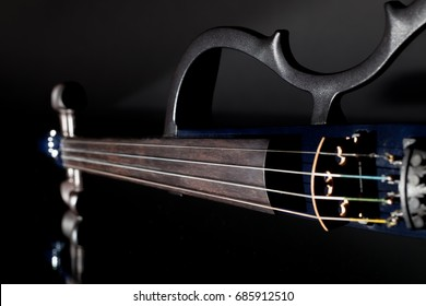 Electric violin. Modern orchestra musical instrument used in contemporary popular classical music.