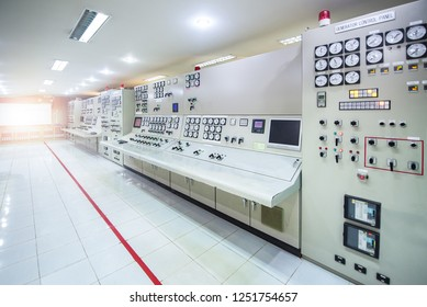 Electric voltage control room. Electricity control panel with buttons and levers at control room of modern thermal power plant with warning red line. - factory industrial concepts