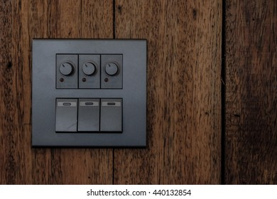 Electric wall switch on old wood wall