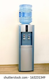 Electric water cooler against the background walls of the office