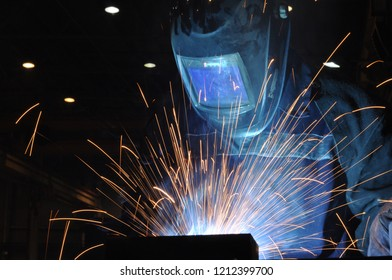 electric welder brews steel at the factory