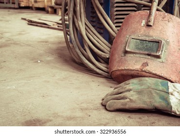 Electric welding machine, electric wire, masks, gloves and tongs, are very old