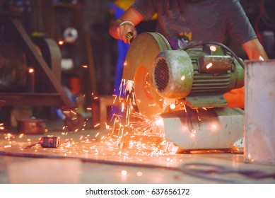Electric wheel grinding on steel structure in factory (Focus on Electric wheel grinding)