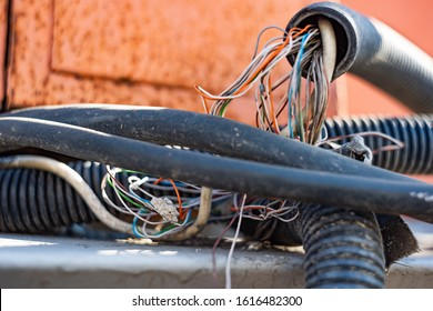 Electric wire in a corrugated hose, soft focus