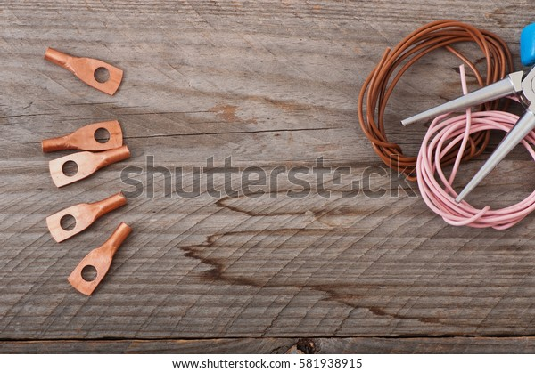 Electric wire on the old wooden background.