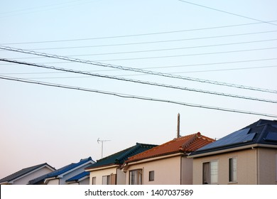 Electric wire and telephone pole in residential area