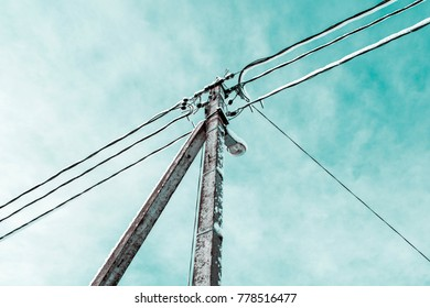 electric wires, street lamp against the blue sky, snow