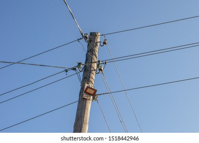 electric wood pole on the blur sky background