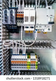 Electrical background. Group of terminal connections,  protective automatic switches, electromagnetic relays and starters.