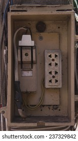 electrical board with terminals and cutout on electricity post.
