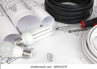 Electrical cable and bulbs on the construction drawings. Repair and construction of electric systems