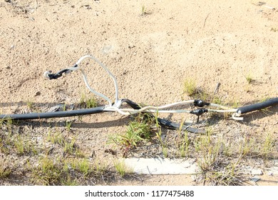 the electrical cable is on the ground. careless Connection of an electrical cable break