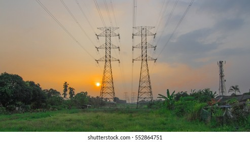 Electrical cable and pylon with sunset at back