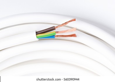 Electrical cable with three insulated conductors. Horizontal. Power cable cross-section. Cable jacket with wire insulation and flexible stranded copper wires. IEC standard color code. Macro photo.