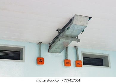 Electrical cable tray for cable routing between electrical distribution panel with equipment at bottom of upper floor. Selective focus