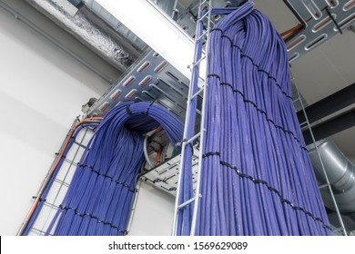 Electrical cables are located in a cableway on the roof of a building