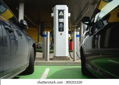 Electrical cars charging battery at station