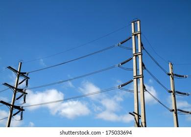 Electrical concrete pole on blue sky