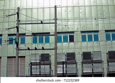 Electrical concrete pole on building