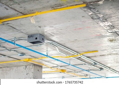 Electrical conduit for cable routing between electrical distribution panel with Galvanized electrical junction box and Pipe of electricity line installed in buildings. Selective focus.