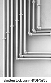 Electrical conduit forming a pattern of lines on a wall.