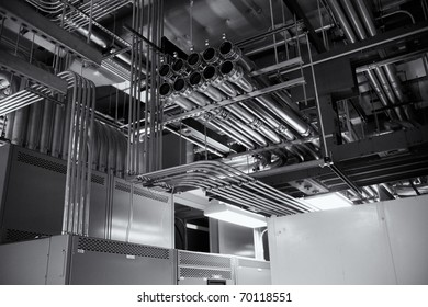 Electrical conduits for a 4000 ampere transfer switch,  black and white.