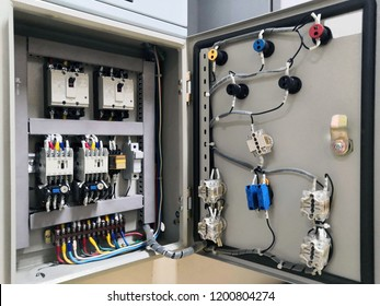 Electrical connector in power lines. Industrial electric enclosure, switch control panel board.Electrical panel at a assembly line factory. Controls and switches.