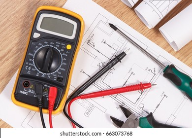 Electrical construction blueprint, drawings or diagrams, multimeter for measurement in electrical installation and accessories for use in engineer jobs