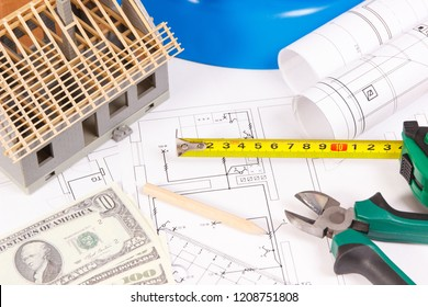 Electrical construction drawings or diagrams, work tools and accessories for engineer jobs, small house and currencies dollar, building home cost concept