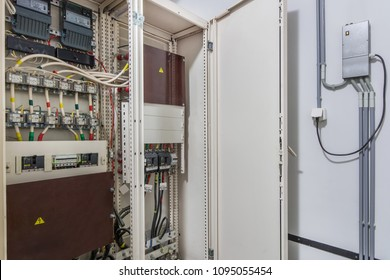 Electrical control cabinet with an open door