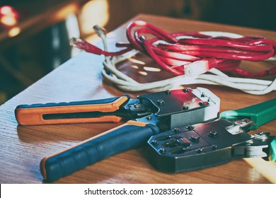 Electrical crimp tools and wire on the office table in sun light toned