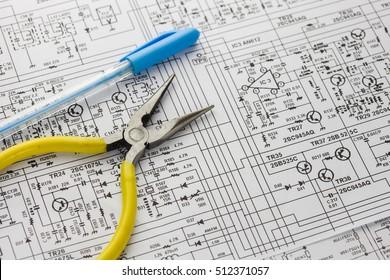Electrical drawing with tool such as pliers and pen.
