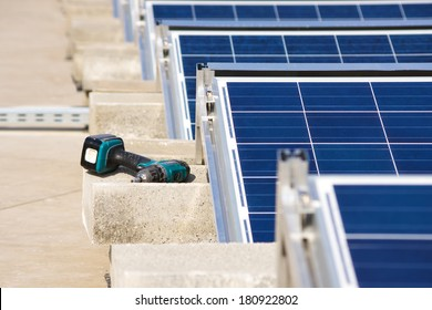 Electrical drill or borer by the solar panel flat roof construction