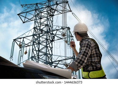 Electrical engineer control wiring electric power on steel tower,  Electric construction and maintenance services throughout, Electric Power Transmission Infrastructure, Highest voltage transmission