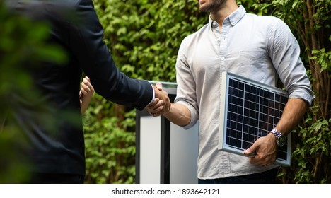 Electrical Engineer Technician and CEO executive business people making handshake after meeting. clean and green alternative energy concept.