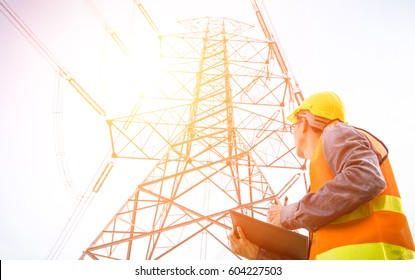 Electrical engineer working check high voltage pole Power Transmission