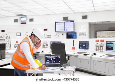 Electrical engineer working at control room of modern thermal power plant