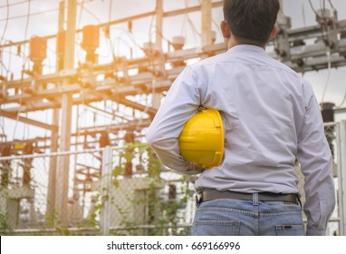 Electrical engineer working  and  standing in front of power plant