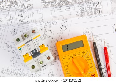Electrical engineering drawings, modular circuit breaker and digital multimeter. Electrical network protection and switching.